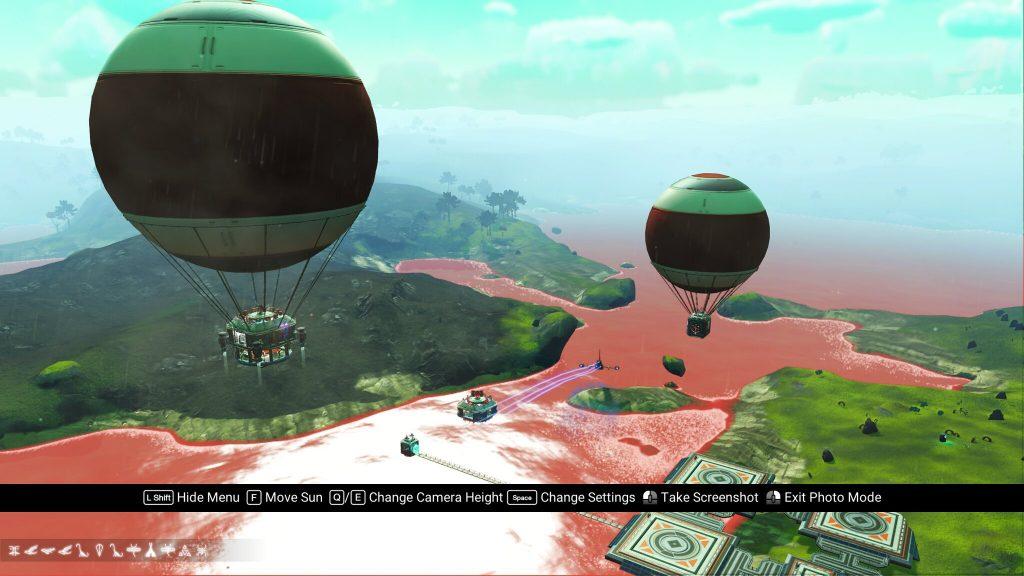 """Hot Air Balloons"" above a river in a No Man's Sky screenshot"