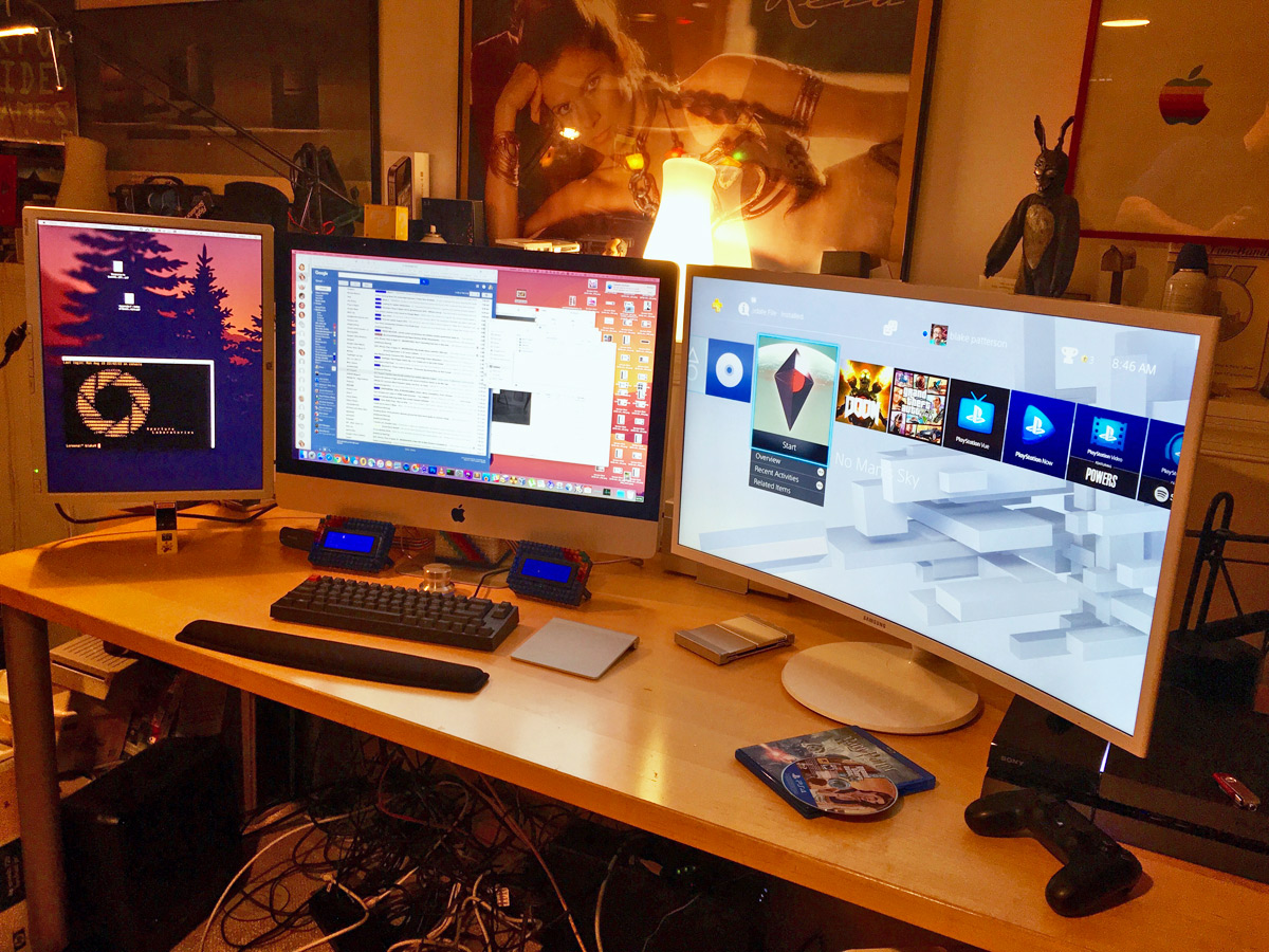 photo of computer desk with iMac on the left and a gaming PC on the right