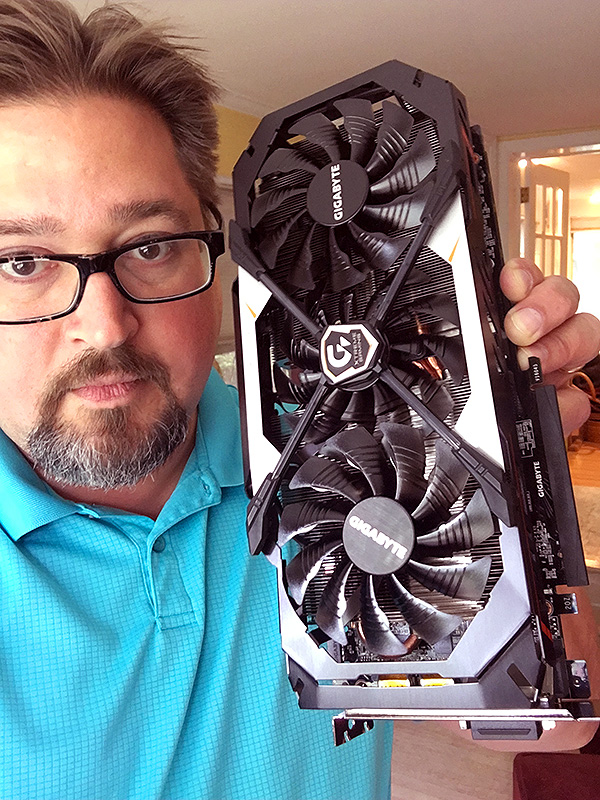 Blake holding a GeForce graphics card